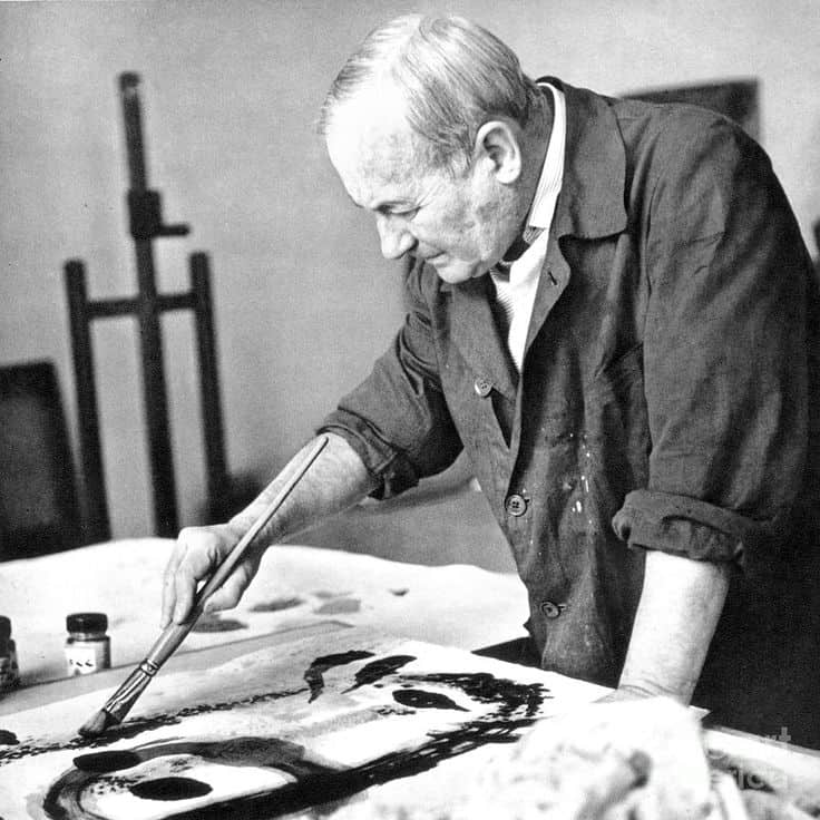 Miro travaillant sur une pierre lithographique